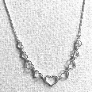 Avon Jewelry - Avon silver hearts necklace